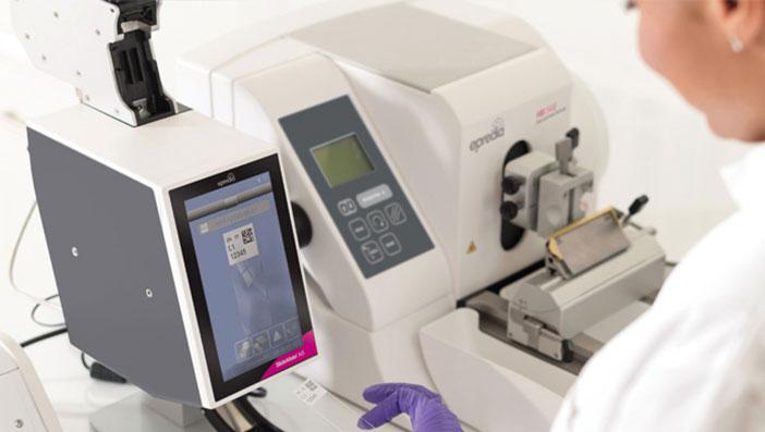 Lab worker using equipment